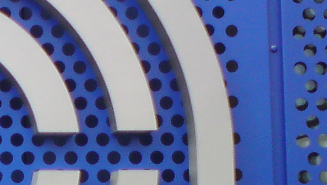 Close up of the logo on the side of the building made from built up Stainless Steel