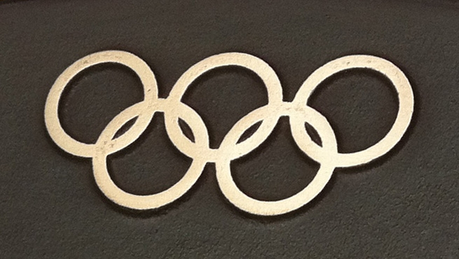 The Olympic Symbols featured on a Cast Bronze Plaque
