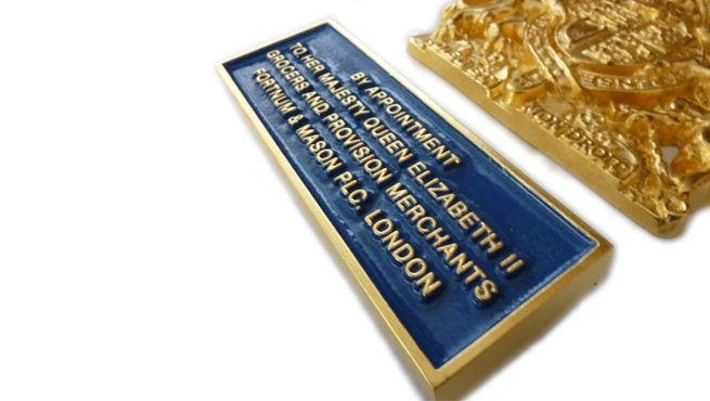 Gold Leafed Citation plate for Fortnum and Mason PLC