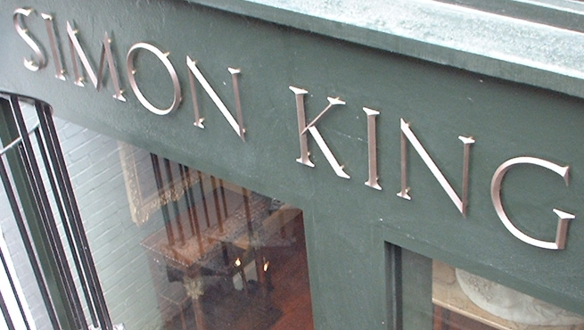 Simon King - Solid Bronze Cast Lettering in Trajan Font