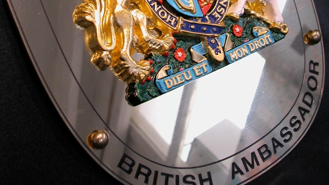 Clost up of Gilded Coat of Arms and Plaque for the British Ambassador