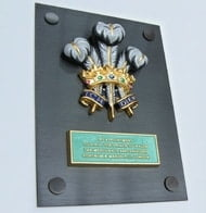 Royal Warrant, Cast aluminium plaque
