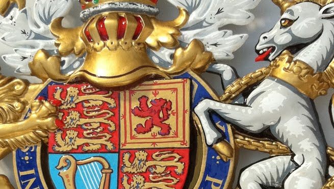 Close up of HRH The Queen's Coat of Arms in Cast Aluminium