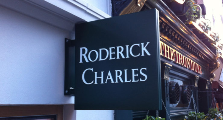 Projecting Sign on shop front of Roderick Charles with Cut out Lettering