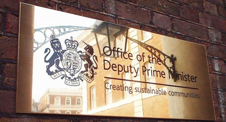 Office of the Deputy Prime Minister - Polished Stainless Steel Plaque in the Sunlight