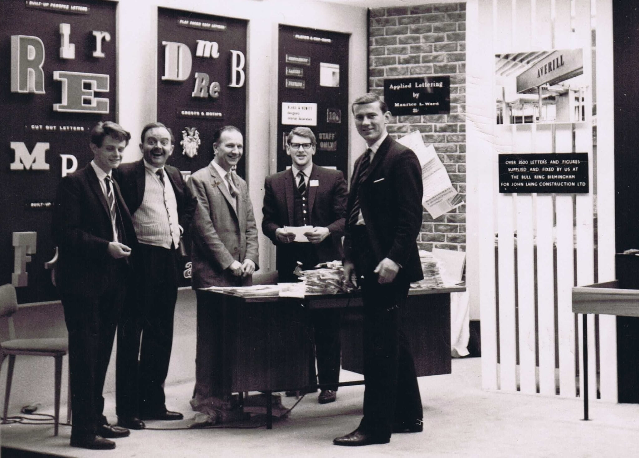 Ward Signs History Maurice Ward With Other Staff Exhibiting at a Tradeshow