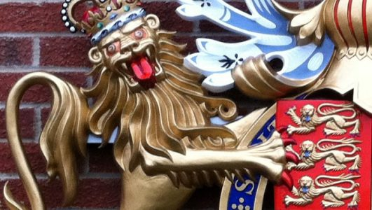 Close up of the statant guardant lion on the Royal Warrant Coat of Arms