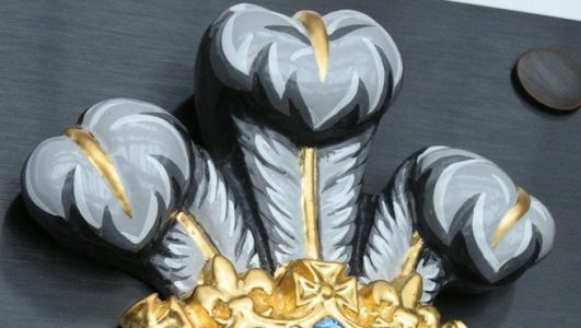 Close up of the fleur de lis on the Prince of Wales Royal Coat of Arms