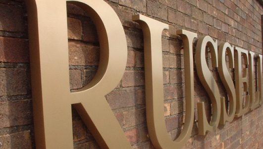 Wall-Mounted Fabricated Stainless Steel Lettering for Russell